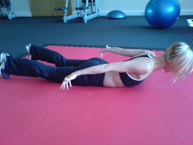 Image of Sharpbodies Personal Training Vikki doing prone cobra, the corrective exercise for a bend pattern movement