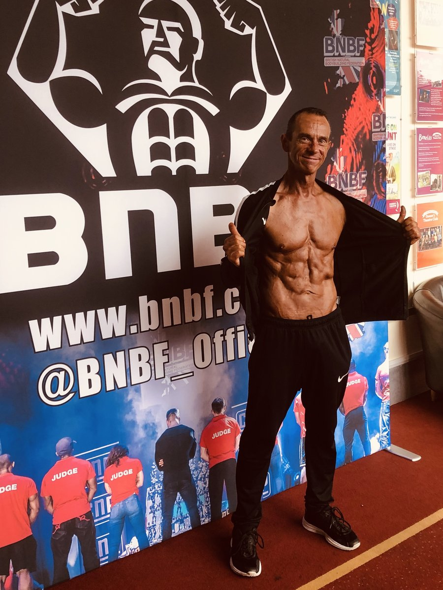 image showing Tim poses at the 2019 BNBF Central Contest on his way to collect 3<sup>rd</sup> spot in the Over 50s category.