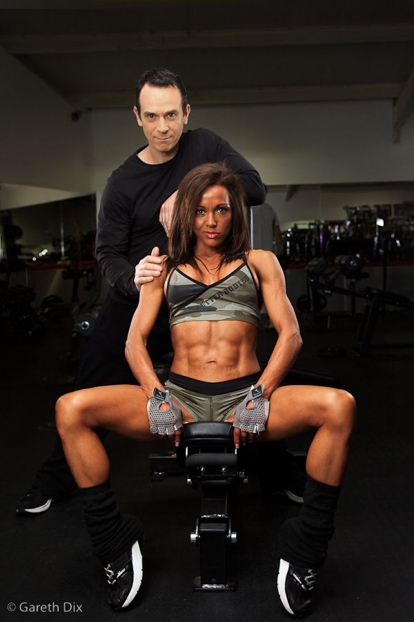 Image of Rachel and Tim relax in the gym after a workout